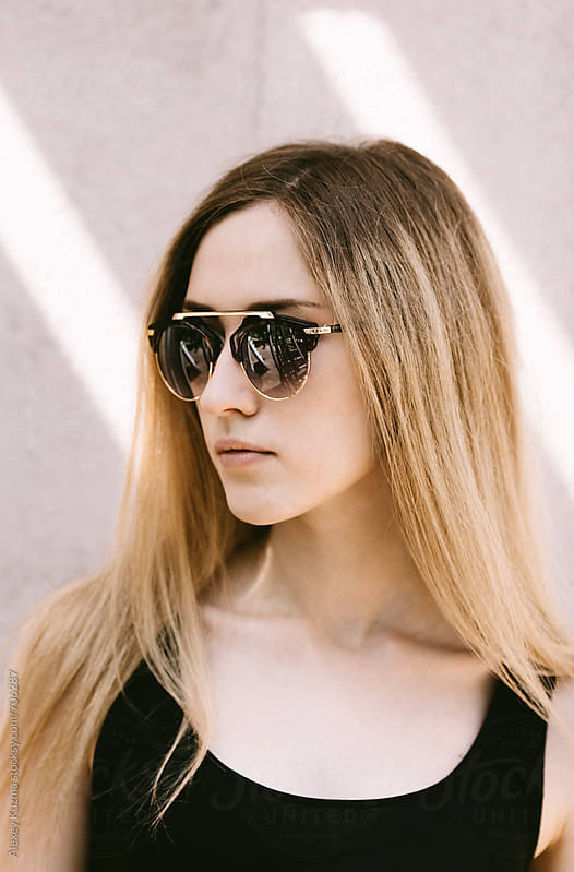 summer portrait of young woman with sunglasses by Alexey Kuzma for Stocksy United