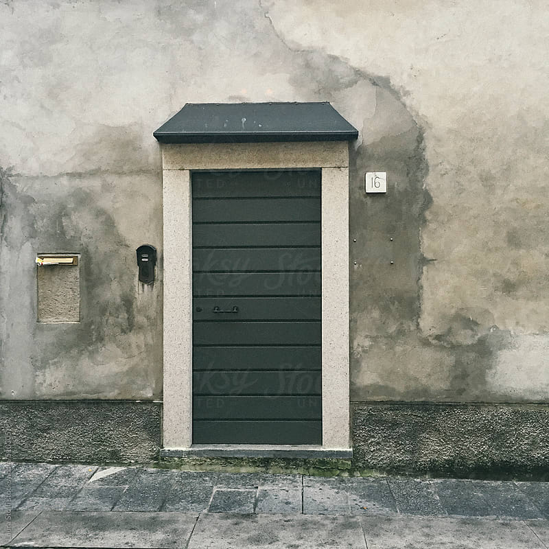 Door in ancient building in Italy by Laura Stolfi for Stocksy United