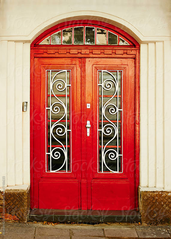 red door by Atakan-Erkut Uzun for Stocksy United