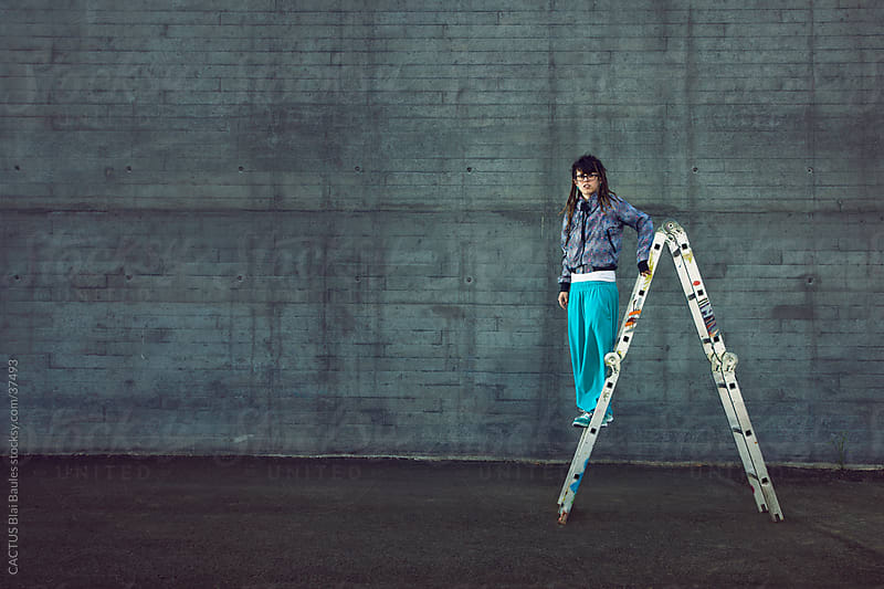 Girl climb a ladder. by CACTUS Blai Baules for Stocksy United