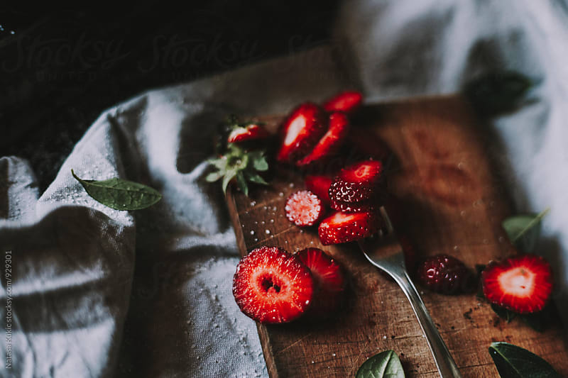 Strawberries and sugar by Natasa Kukic for Stocksy United