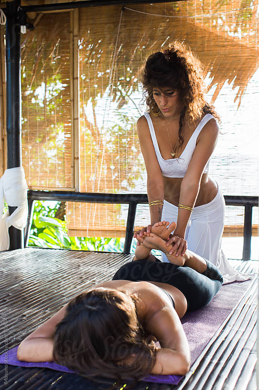 Woman Giving Massage to a Client by Mosuno for Stocksy United
