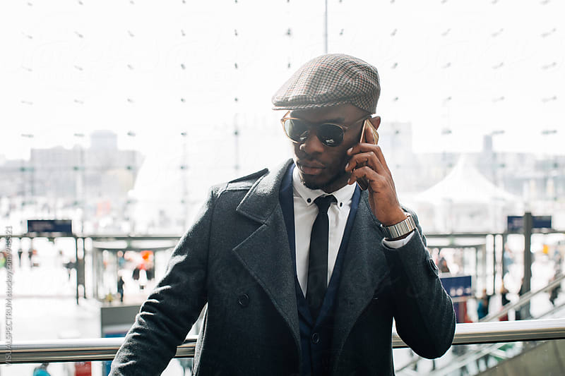 Portrait of Stylish Young Black Businessman Making Phone Call by Julien L. Balmer for Stocksy United