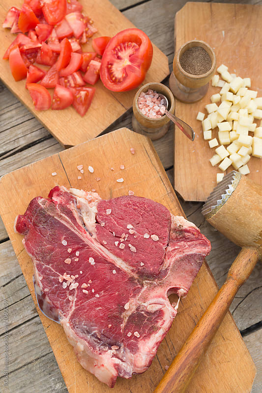 Raw meat and spices on the table by RG&B Images for Stocksy United