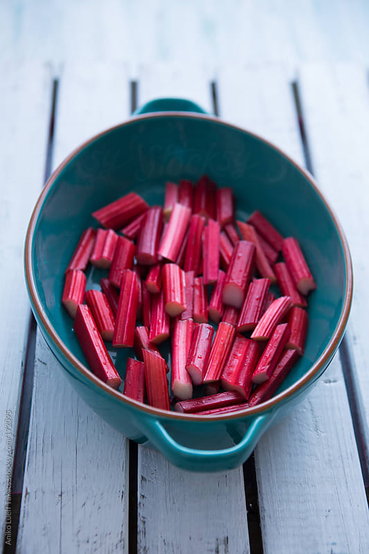 Chopped rhubarb in cast iron pan by Aniko Lueff Takacs for Stocksy United