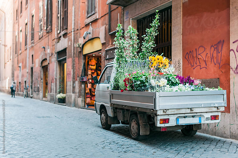 Old Truck on a Street in Italy full of Flowers by Briana Morrison for Stocksy United
