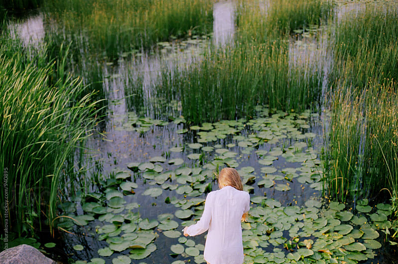 Woman among overgrown lake sedge by Lyuba Burakova for Stocksy United