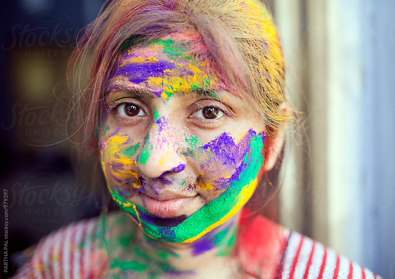 Indian woman with colorful face in Holi festival by PARTHA PAL for Stocksy United