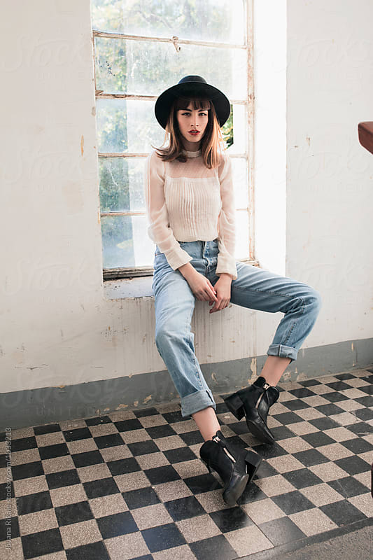 Fashionable young woman in an old building by Jovana Rikalo for Stocksy United