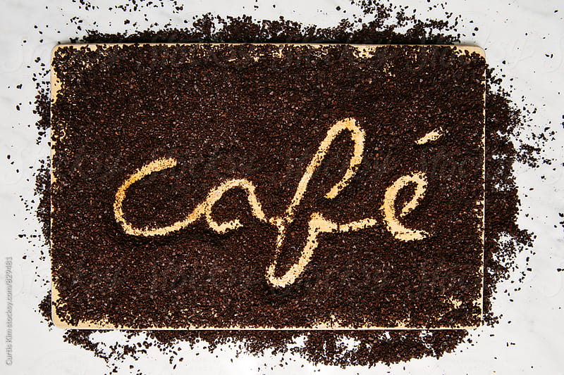 Cafe written in coffee grind by Curtis Kim for Stocksy United