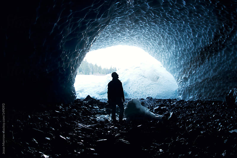 Man in Ice Cave by Jesse Morrow for Stocksy United