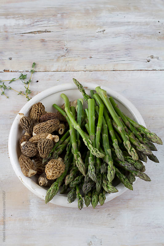 Morels and green asparagus in bowl by Noemi Hauser for Stocksy United