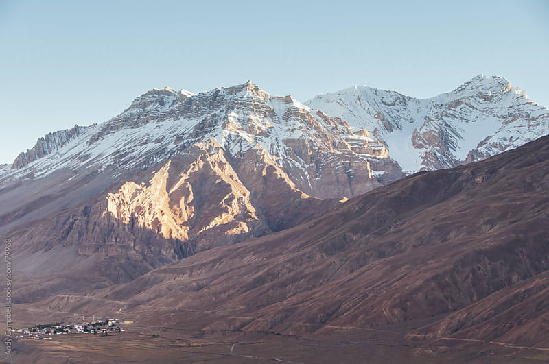 A remote village sits in the shadow of The Himalaya Mountains by Andy Campbell for Stocksy United