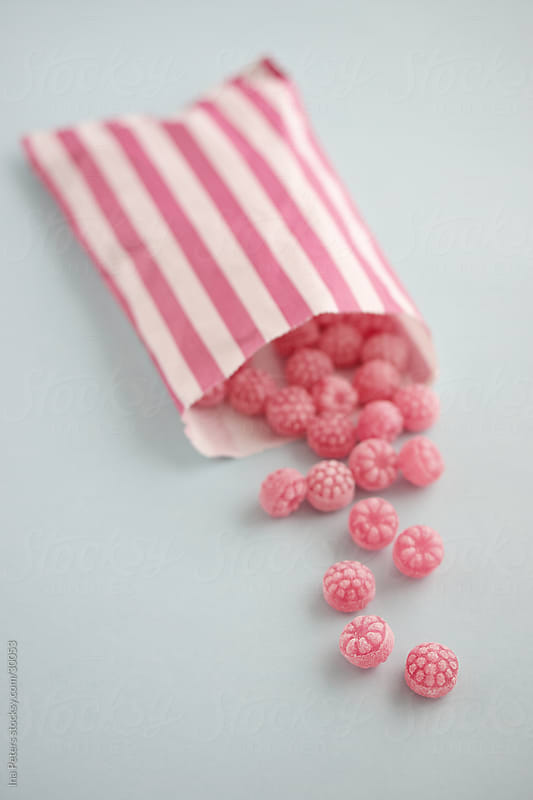 Food: Pink Raspberry Drops, pastel colours by Ina Peters for Stocksy United