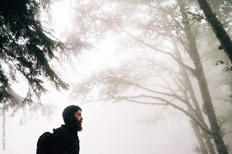 Portrait of young man in fog by Isaiah & Taylor Photography for Stocksy United