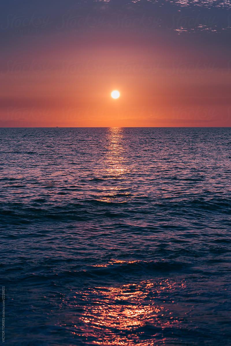 Purple Sunset In The Mediterranean Sea By Victor Torres Stocksy United