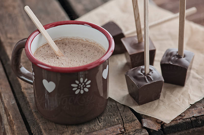 Food: Homemade Hot Chocolate on brown wood table by Ina Peters for Stocksy United