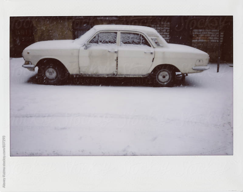 Old car covered in Snow by Alexey Kuzma for Stocksy United