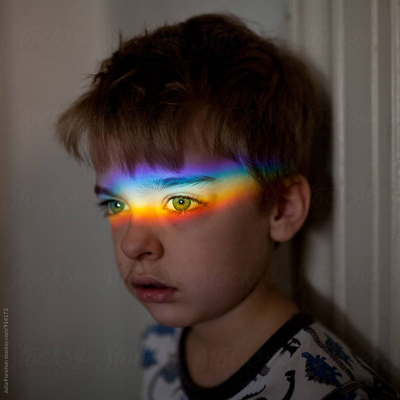 Young boy with rainbow across his eyes. by Julia Forsman for Stocksy United