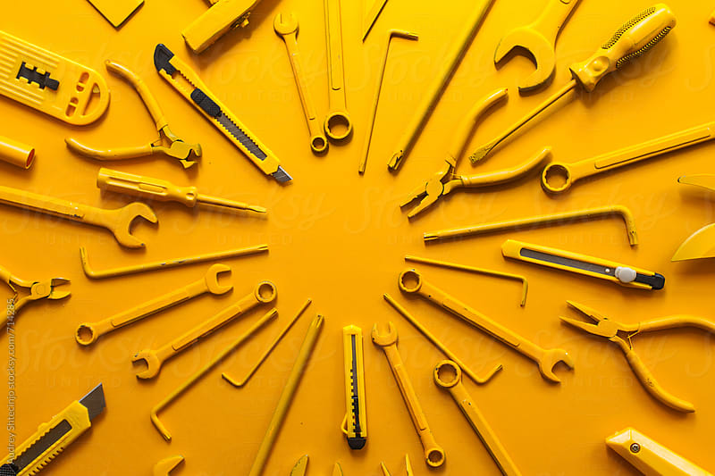 yellow work/handtools of a craftsman arranged. by Audrey Shtecinjo for Stocksy United
