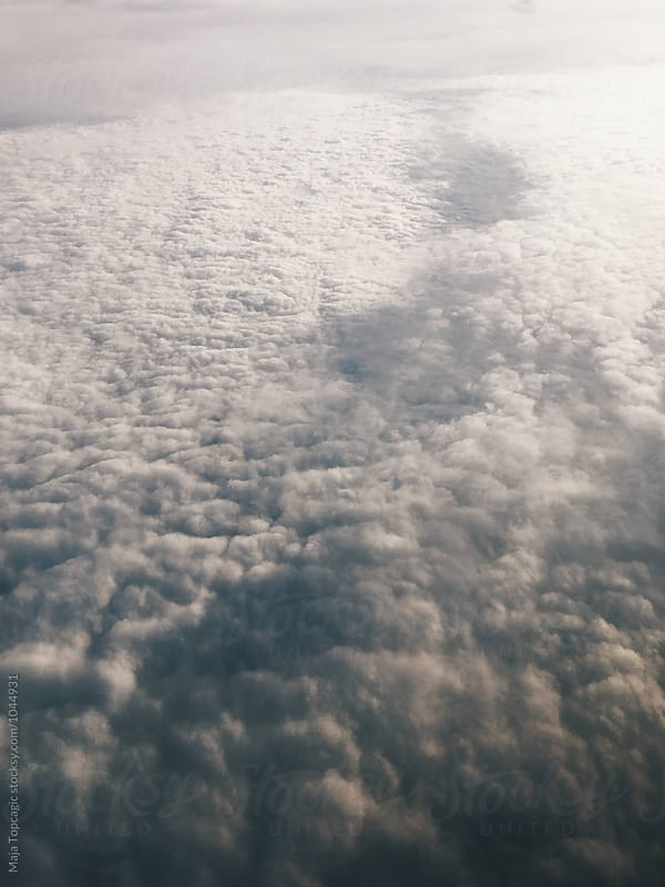 Clouds shot from an aeroplane by Maja Topcagic for Stocksy United