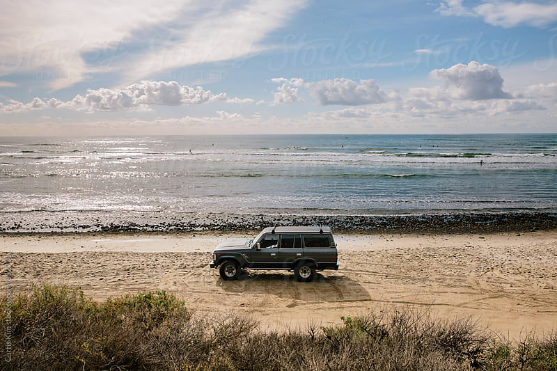 Vintage truck parked at the beach by Curtis Kim for Stocksy United