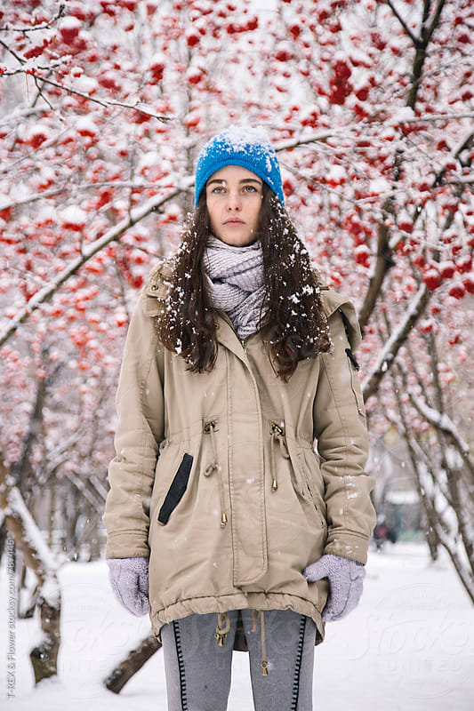 Beautiful young woman standing against of rowan-trees by T-REX & Flower for Stocksy United