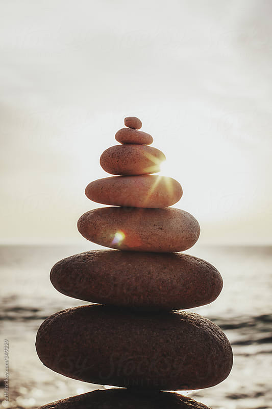 Zen rock stack balance with sunshine by paff for Stocksy United
