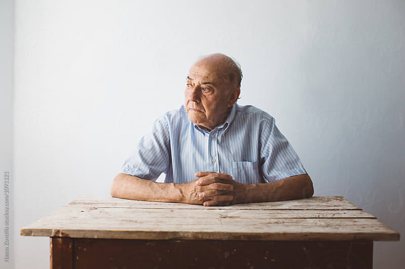 Portrait of a senior man indoor by Nasos Zovoilis for Stocksy United