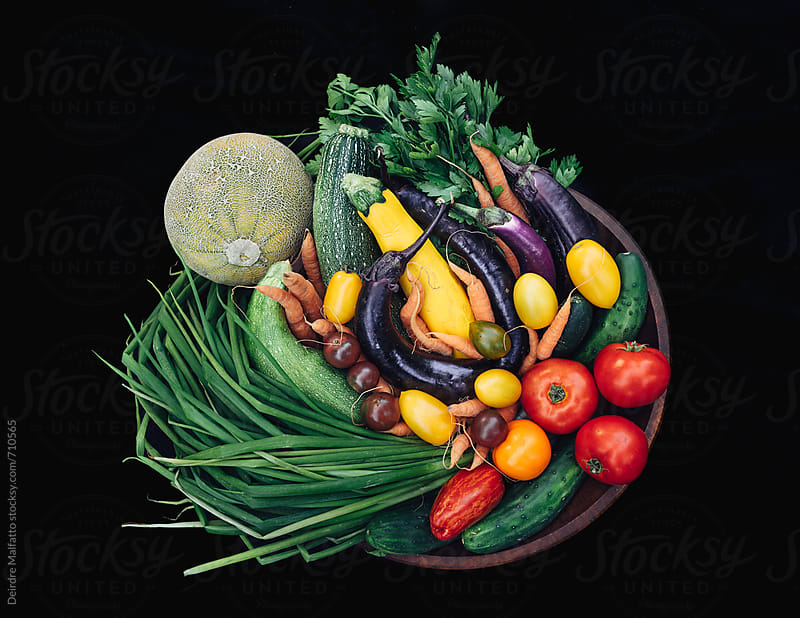 looking down at an abundance of fresh vegetables by Deirdre Malfatto for Stocksy United