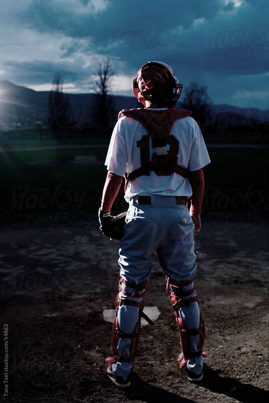 Baseball catcher standing at home-plate.  by Tana Teel for Stocksy United