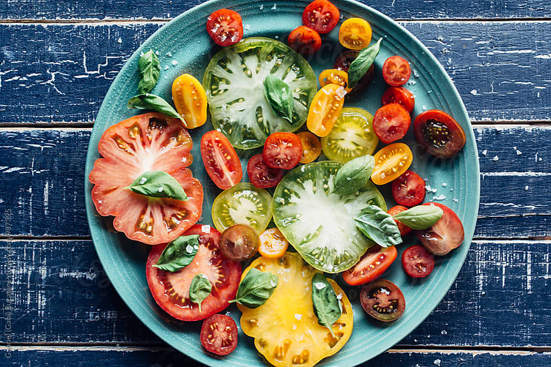 Fresh tomato salad from overhead by Gabriel (Gabi) Bucataru for Stocksy United