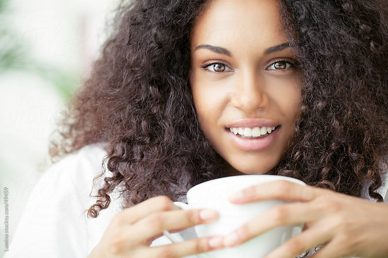 African Woman Drinking Coffee by Lumina for Stocksy United
