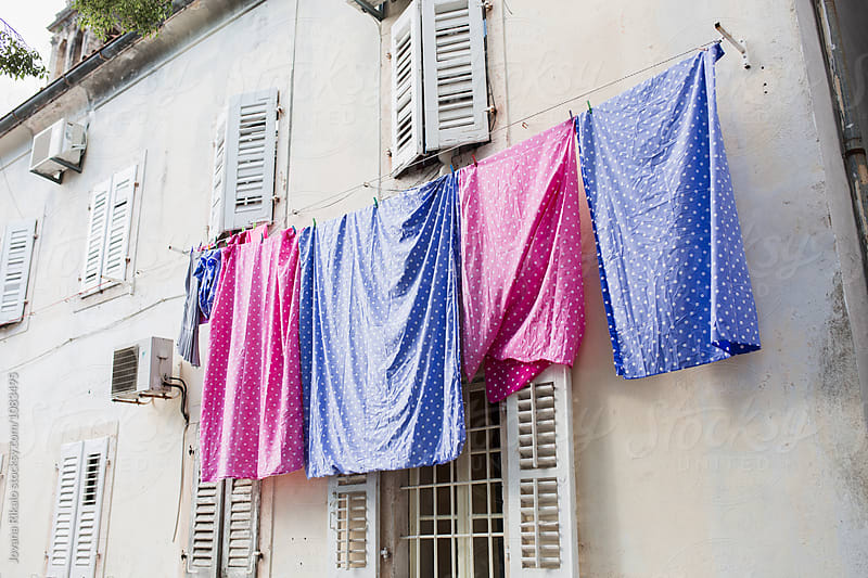 Clothes hangs on the clothesline to dry by Jovana Rikalo for Stocksy United