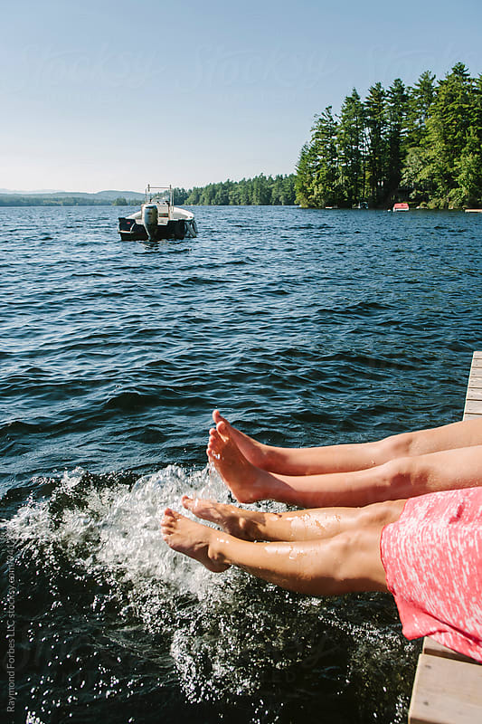 Feet in the Lake by Raymond Forbes LLC for Stocksy United