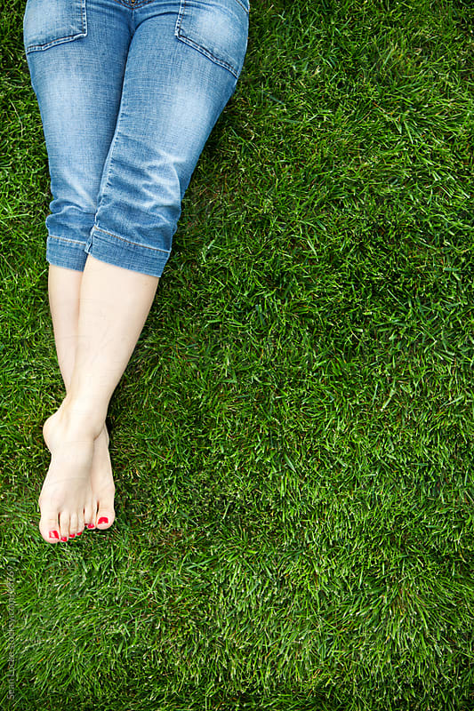 Grass: Woman's Feet in Grassy Yard by Sean Locke for Stocksy United
