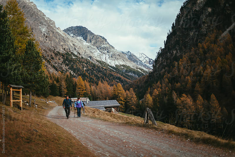 Couple hiking in the nature by Davide Illini for Stocksy United