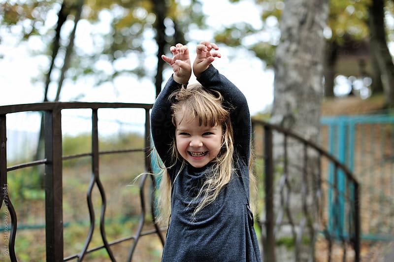 Laughing little girl by Svetlana Shchemeleva for Stocksy United