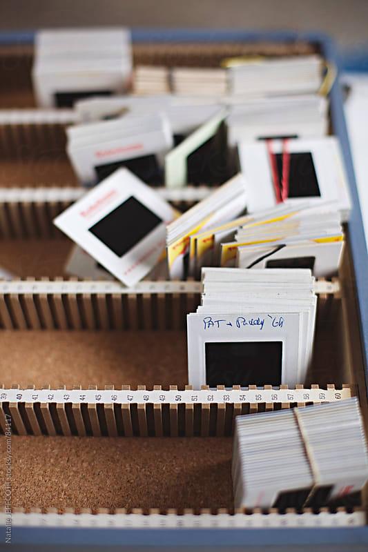 box of old family slides by Natalie JEFFCOTT for Stocksy United