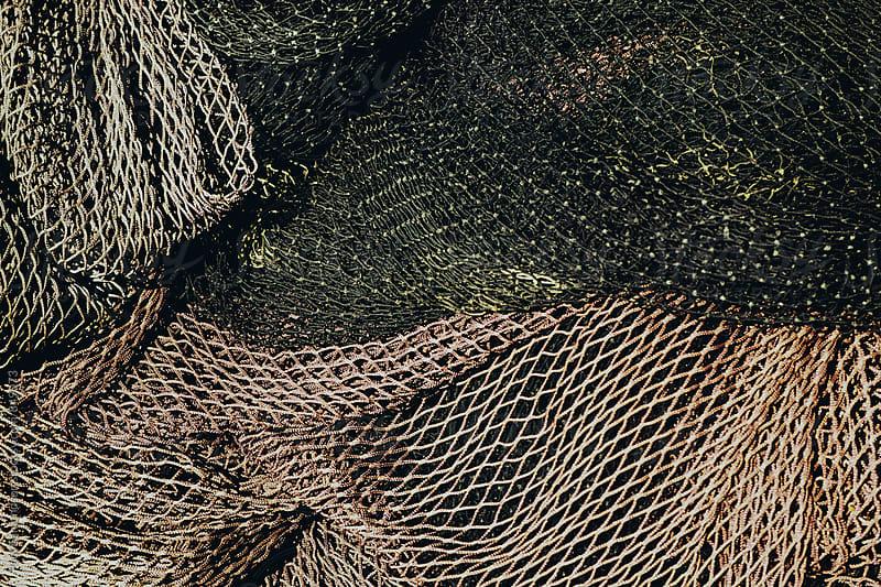 Pile of commercial fishing nets by Paul Edmondson for Stocksy United