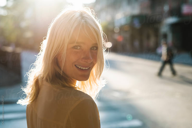 Beautiful happy blonde woman in the city by WAVE for Stocksy United