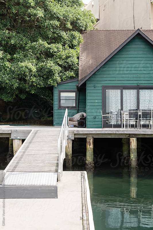 old boat house with ramp by Gillian Vann for Stocksy United