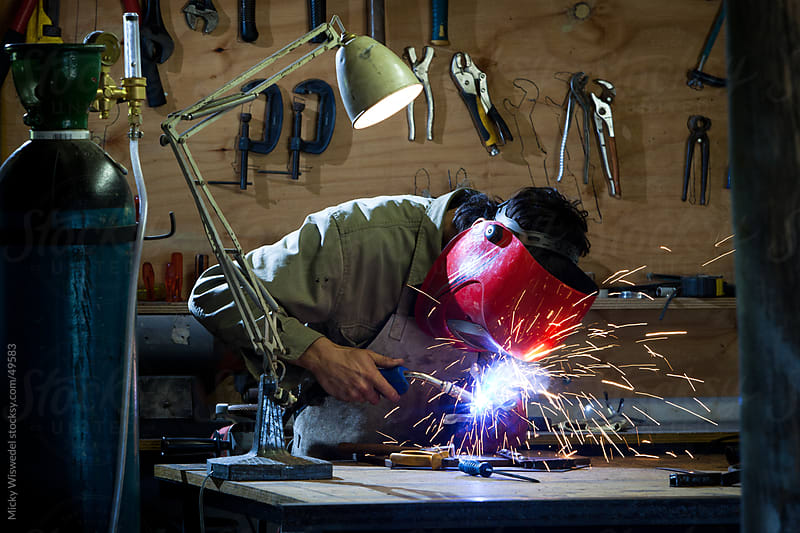 Welder welding in a workshop by Micky Wiswedel for Stocksy United