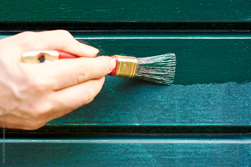 Painting a kitchen door by Harald Walker for Stocksy United
