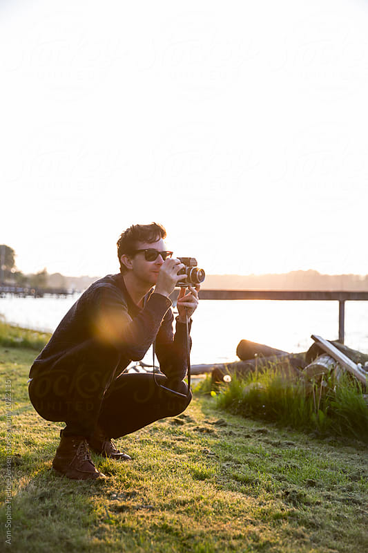 A man taking pictures by Ann-Sophie Fjelloe-Jensen for Stocksy United