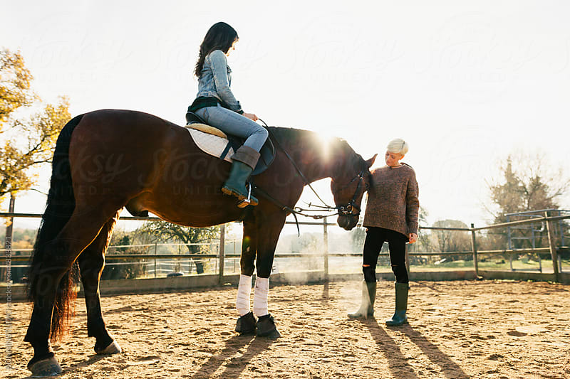 Women riding a horse on a farm. by BONNINSTUDIO for Stocksy United