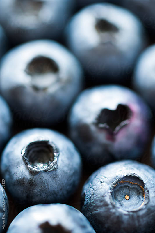 Blueberries in closeup . by Alexey Kuzma for Stocksy United