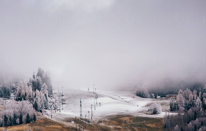 Snow clouds brings first snow fall to the mountain ski slopes in Austria. by Soren Egeberg for Stocksy United