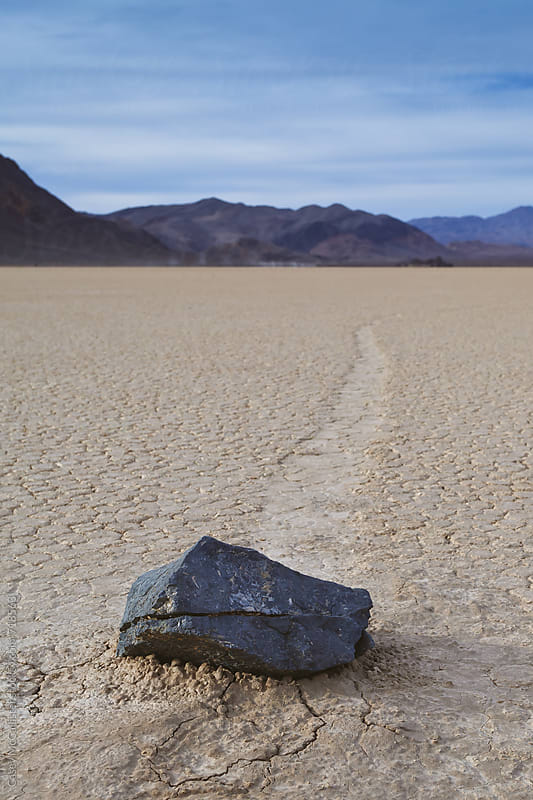 Death Valley Moving Rocks by Casey McCallister for Stocksy United