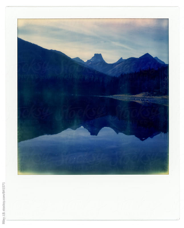 Instant photograph of a pond & mountains by Riley Joseph for Stocksy United